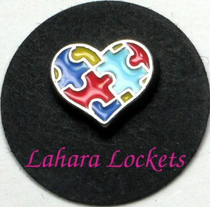 This floating charm is shaped like a heart and has a multicolored puzzle design on it.