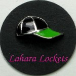 This floating charm is a black and green baseball cap.