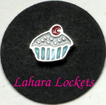 This floating charm is a cupcake with blue liner, white frosting and red cherry on top.