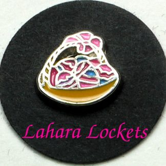 This floating charm is a yellow basket with pink ribbon that holds a variety of multi-colored Easter eggs.
