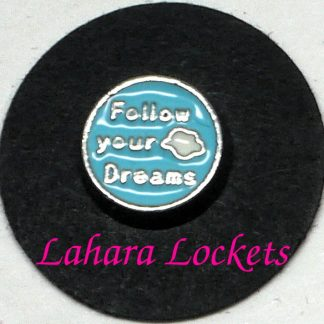 This floating charm is a blue cirle that says follow your dreams in silver with a white cloud accent.