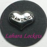 This floating charm is a silver, heart inscribed with the word grandkids.