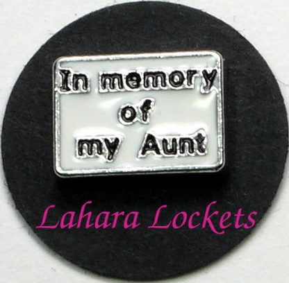 """This floating charm is a white rectangle that says """"in memory of my Aunt"""" in black letters."""