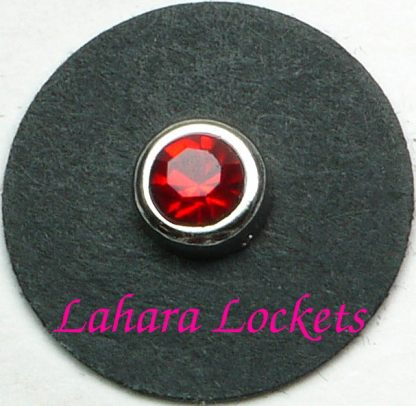 This floating charm is a red, July birthstone surrounded my silver colored metal.