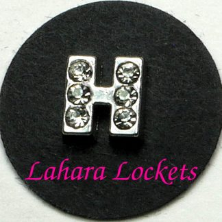 This floating charm is a silver letter H with clear gems.