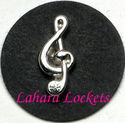 This floating charm is a silver, treble clef with a gem accent at the bottom.