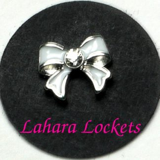 This floating charm is a white bow with a clear gem in the center.
