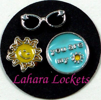 This is a trio of floating charms that would look together in a memory locket; you are my sunshine, sun and sunglasses.