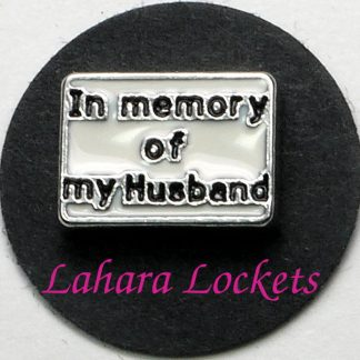 This floating charm is a white rectangle that says in memory of my husband in black letters.