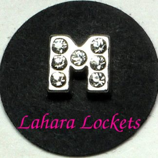 This floating charm is a silver letter M with clear gems.