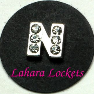 This floating charm is a silver letter N with clear gems.