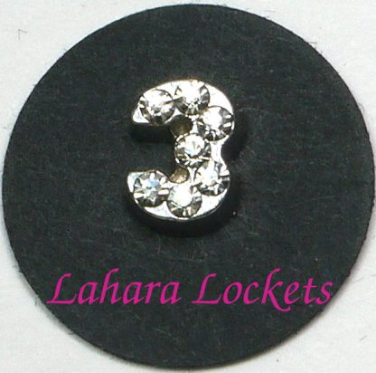 This floating charm is a silver, number three with clear gems.