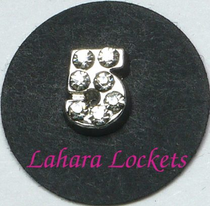 This floating charm is a silver, number five with clear gems.