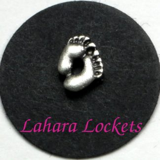 This floating charm is two, silver colored baby feet.