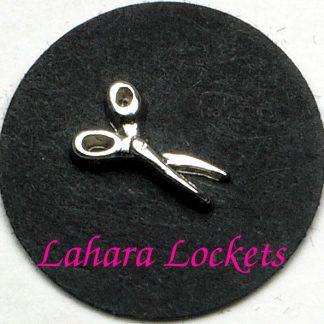 This floating charm is a pair of silver scissors.