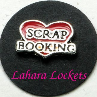 This floating charm is a red heart that says scrap booking in black and silver.